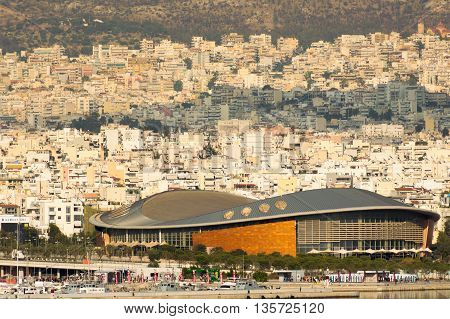 Athens, Greece 7 Jume 2016. Tae kwon do stadium in Greece Piraeus. Landscape view of the city with the stadium as foreground.
