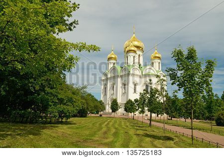 23.06.2016 .Russia.The Town Of Pushkin.The photo shows a city Park.Cut down the grass on the lawn.In the distance stands the Church.