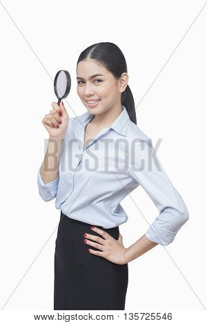 business woman look in Magnifier isolated on white background asian