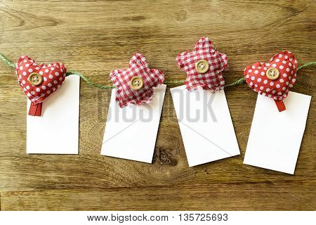 heart and star clothespins with cards for background