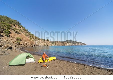 Men go kayaking along the coast in the summer.