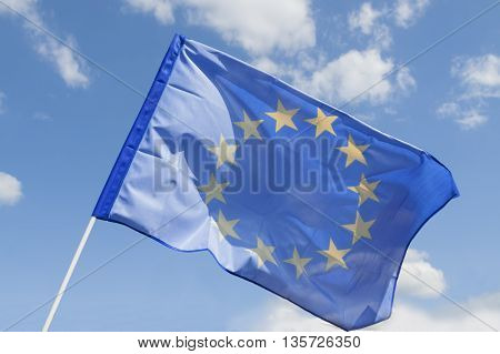Flag of European Union Flying against the sky sunlit