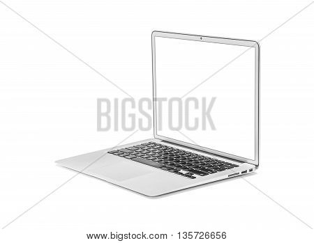 Silver laptop isolated on white background with clipping path. Side view.