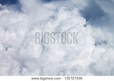 Heavy clouds out of an airplane window 10000m