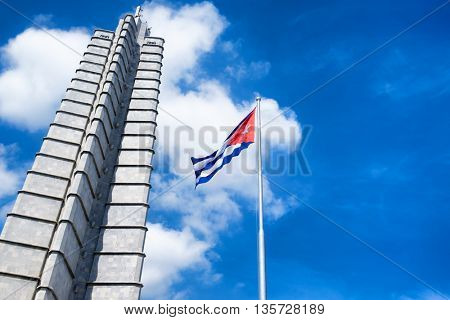 HAVANA,CUBA - JUNE 21,2015: Monument and cuban flag at the Revolution Square in Havana on a beautiful summer day