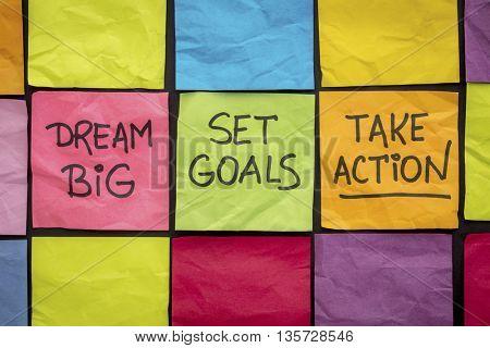 dream big, set goals, take action - motivational advice or reminder on colorful sticky notes