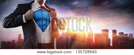 Businessman Superhero With Sunset In City-Power Concept