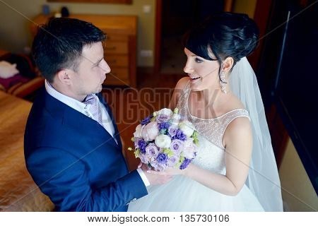 Handsome Groom Is Seeing First The Beauty Bride In The Morning. Meeting Of A Wedding Couple. Beautif