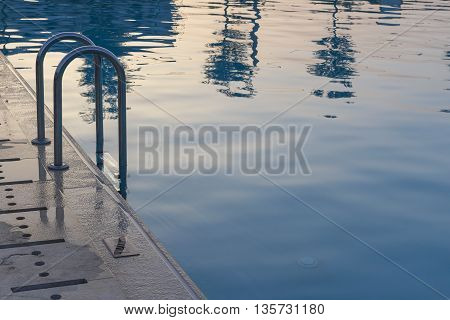 Tranquil Swimming Pool Detail At Sunset For Holiday