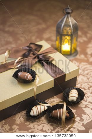 Fanoos, date chocolates and gift box. Delightful Eid celebration.