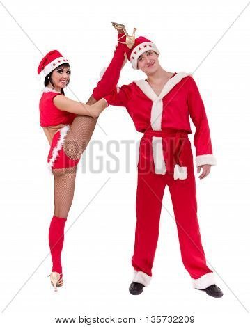 Happy young couple wearing santa claus clothes posing against isolated white background
