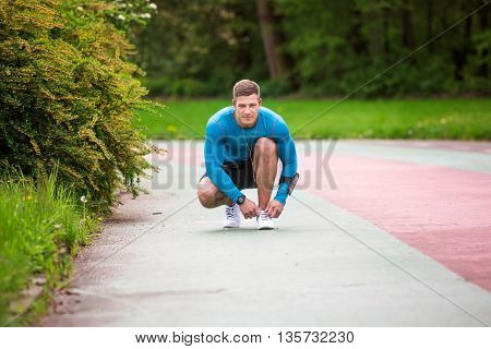Man Tying Laceshoes
