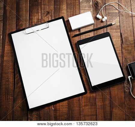 Responsive design template. Blank ID template on wooden table background. Template for branding identity. Mock-up for your design. Top view.