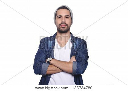 Close up of young latin man serious. Isolated white background.