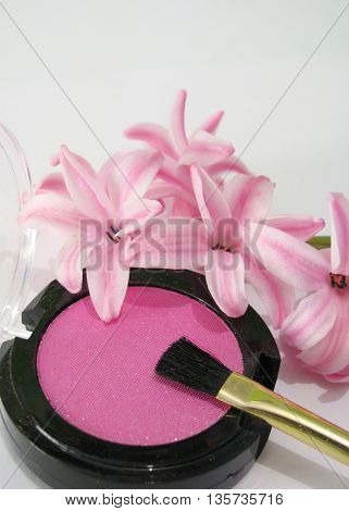 make up and pink flowers