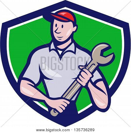 Illustration of a mechanic worker standing looking to the side carrying spanner viewed from front set inside shield crest on isolated background done in cartoon style.