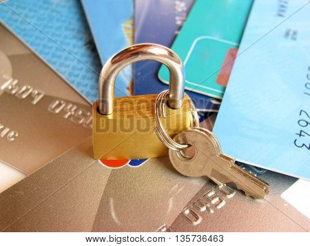Security: Brass padlock on credit card.
