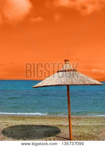 empty beach and umbrella