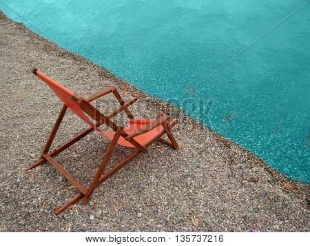 Lonely chair on a coast line of sea