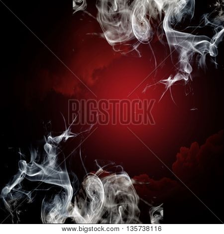 Smoke on black and red background
