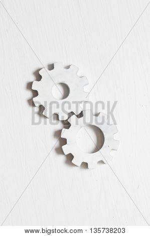 White gears on a on a white table, industry concept