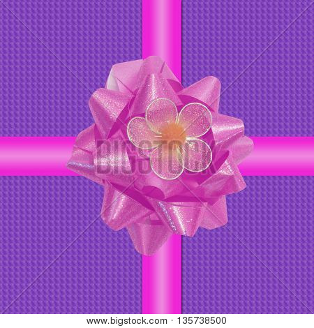 Glossy ribbon isolated on purple background