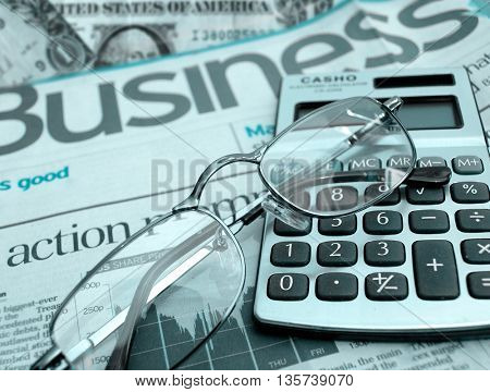 News,calculator and glasses-business concept
