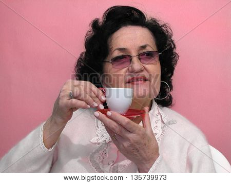 Portrait of attractive mature lady with cup of coffee