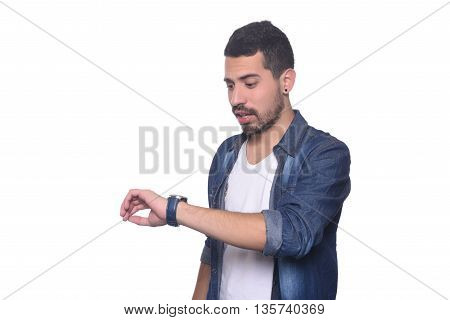 Portrait of young latin man looking at his watch. Isolated white background.