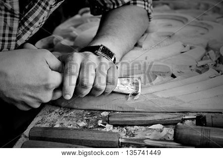 monochrome carvers Hands work with chisel in workshop