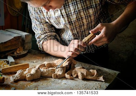 handmade art cutting wood carving with cutter