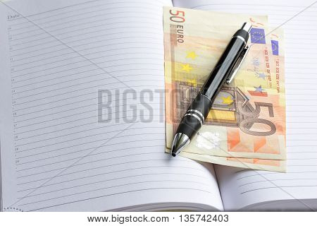 Money euro cash. money in an open notebook