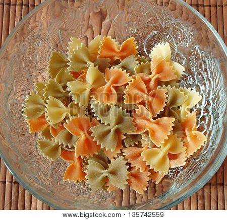 colored pasta  placed in glass plate