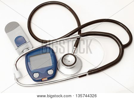 Stethoscope and device for measuring blood sugar level isolated on white background
