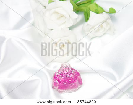 Isolated Nail Polish on satin with white roses