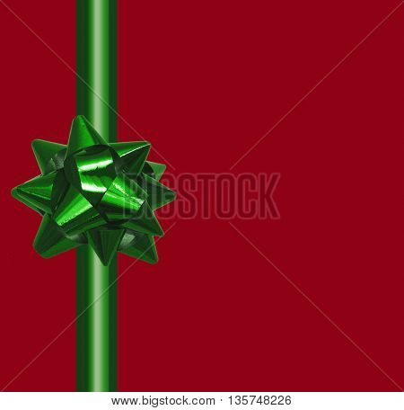 Shiny green satin ribbon on red background