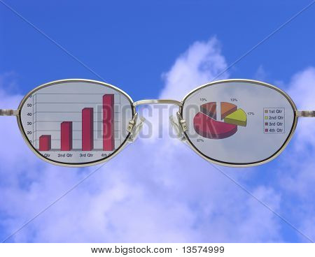A photo of glasses looking into financial charts