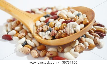 spilled raw beans of different types