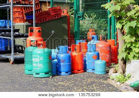 DORSET ENGLAND MAY 29 2016: Camping gas bottles stored on a campsite.