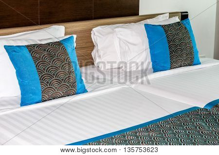 twin bed decorating pillows in the hotel in Thailand