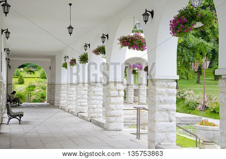 indoor of building. Fantastic background. - A long passage between many old columns