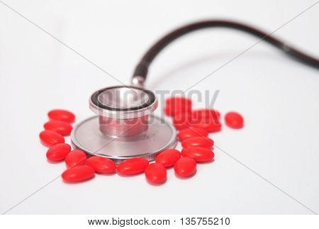 medical concept, pills and stethoscope