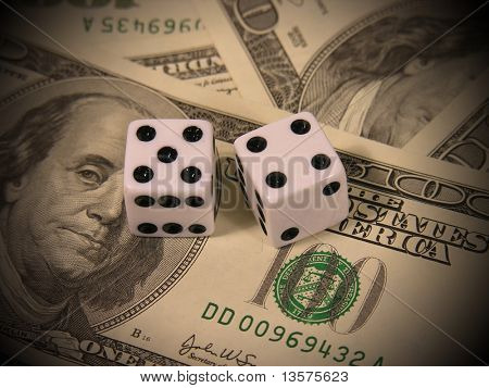 A photo of a pair of dice on money