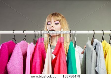 Pretty Woman Looking At Clothes.