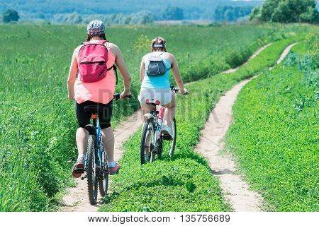 Cycling Girls On Summer Day