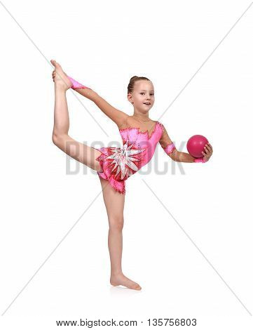 Little girl gymnast with pink ball, close up.