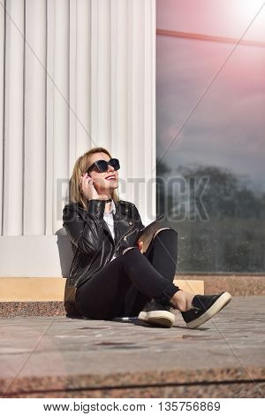 happy hipster girl with touch pad listening to music