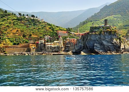 picturesque view from the sea of vernazza and hills