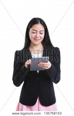 Portrait of successful asian business woman holding tablet computer isolated on white background working on touching screen. Positive human emotion. Studio shot.