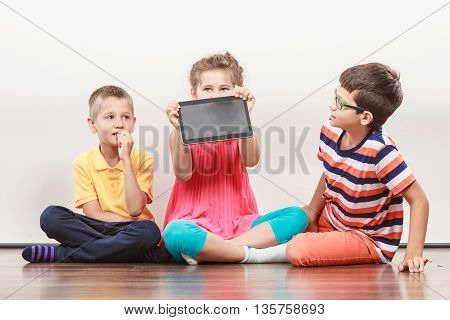 Children Playing On Tablet.